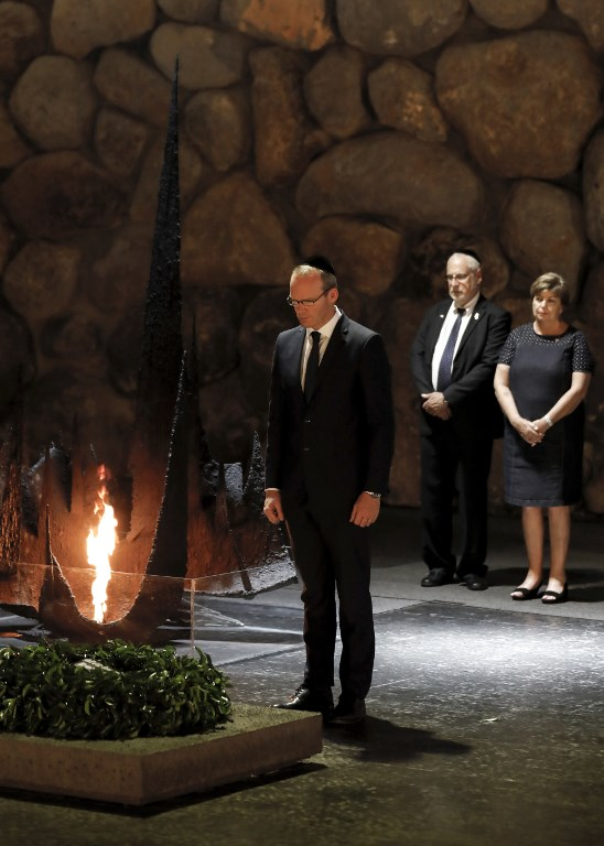 Irish Foreign Minister Simon Coveney lays a wreath at the Hall of Remembrance, where the names of major death and concentration camps are written, during his visit to the Yad Vashem Holocaust Memorial museum commemorating the six million Jews killed by Nazis during World War II, in Jerusalem on July 11, 2017. (AFP PHOTO / GALI TIBBON)