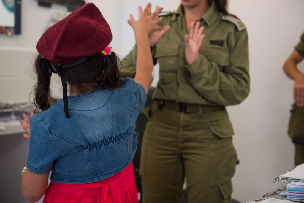 In this undated photo provided on July 19, 2017, an IDF officer attends to a Syrian child as part of the army's 'Good Neighbor' program to provide humanitarian aid for Syrian civilians on the Syrian Golan Heights. (IDF spokesperson)