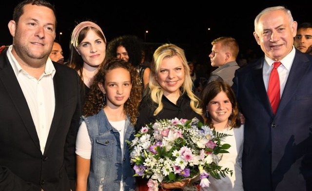 Prime Minister Benjamin Netanyahu (R) and his wife Sara (middle) pose for a photo with Yossi Dagan (L), his wife Oriya (second L) and their two daughters attend an event in the Barkan industrial zone in the West Bank to mark 50 years of settlement in Samaria on August 28, 2017. (Kobi Gideon/GPO)