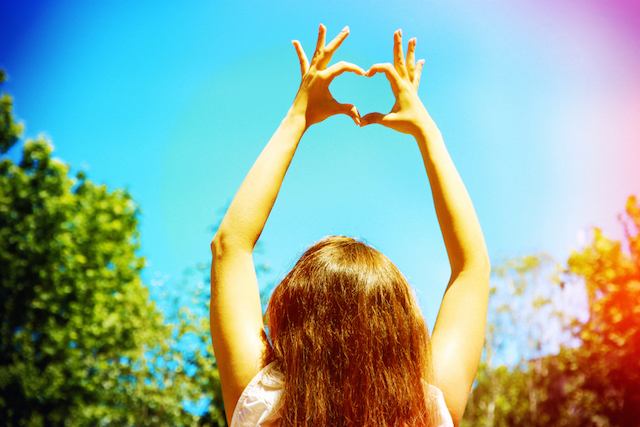 Woman with heart hands