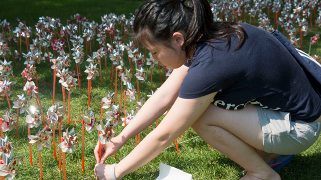 """9/11 today is not a tragedy, but a symbol of unity,"" said Jacqueline Choy, 20, business major, after planting a pinwheel in front of the library."