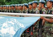 LOS PALOS, EAST TIMOR - JULY 23:  United Nations Peacekeeping Forces (UNPKF) from Thailand hold their guns up during a ceremony to mark the handover responsibility between UN peacekeeping troops and East Timor armed forces in Los Palos, East Timor, 23 July 2002. East Timor's army replaced UN peacekeepers in one district of the new nation -- the first step in a 20-month handover which will see the blue berrets bow out.   (FILM)  (Photo credit should read ANTONIO DASIPARU/AFP/Getty Images)