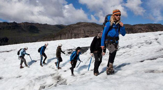 People hiking on a glacier in Iceland.