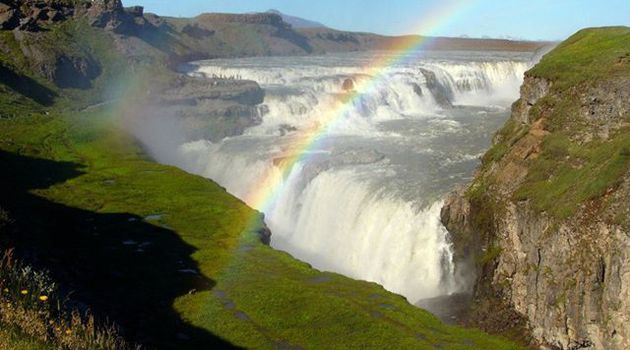 Gullfoss waterfall in Iceland with rainbow.