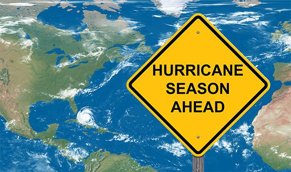 The graphic shows a Hurricane Season caution sign.