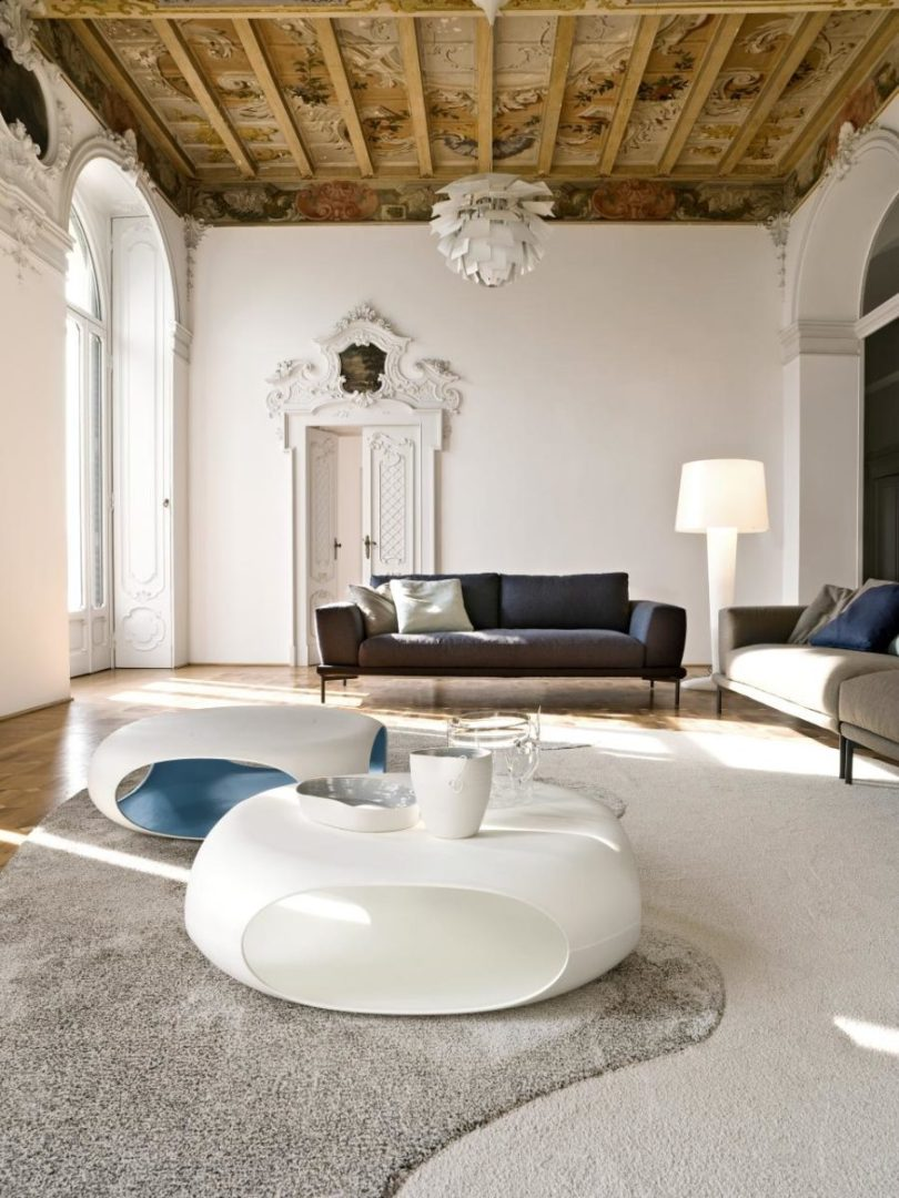 Italian inspired living room with a unique wooden ceiling