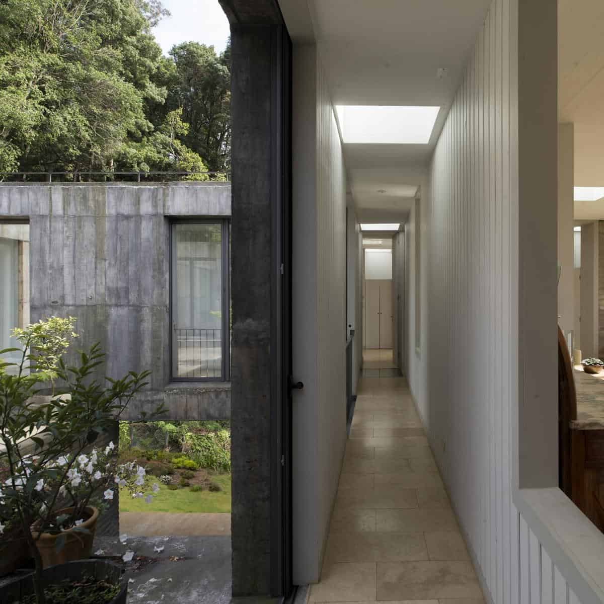 This Fascinating Square Concrete House Sits On A Small