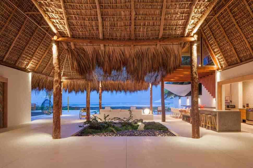 Colorful Tropical Open Home With Rough Cut Thatched Roof