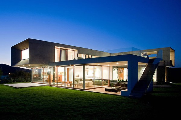 UShaped House with Glass Lower Floor and Concrete Upper