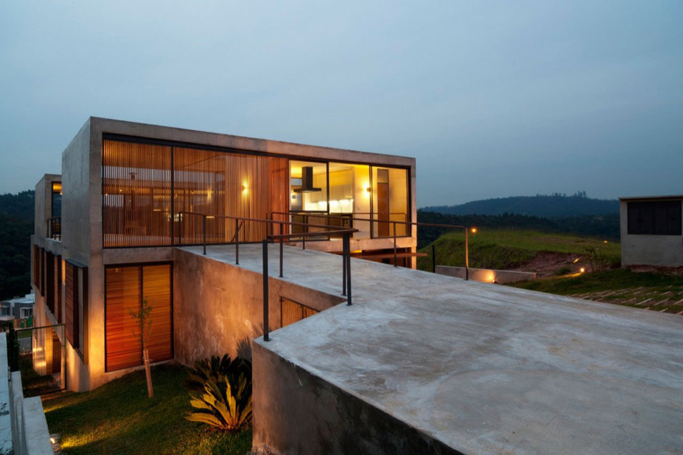 Hillside House With 2 Concrete Volumes, 2nd Story Entrance