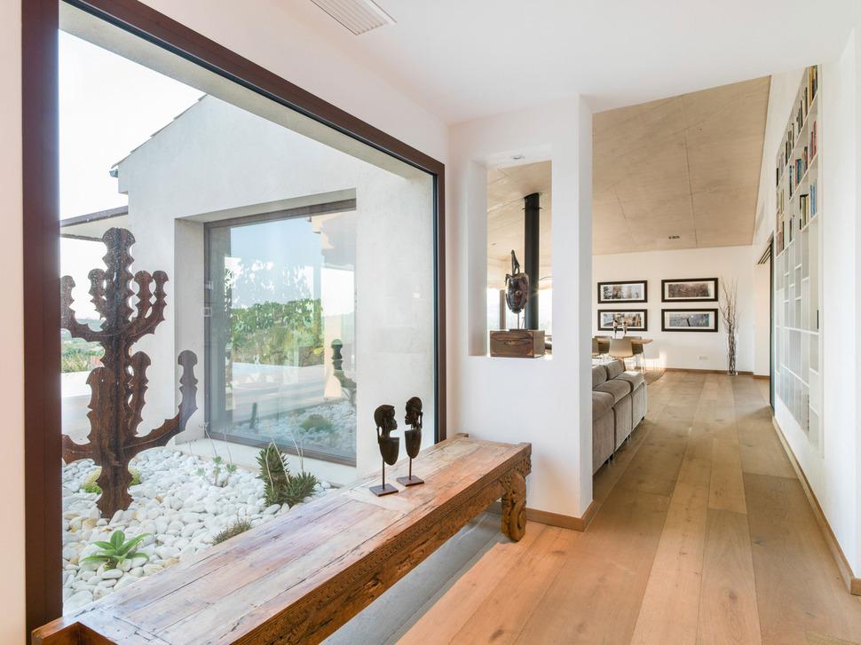 Concrete Home Combines Earth Tones With Minimalist Aesthetic