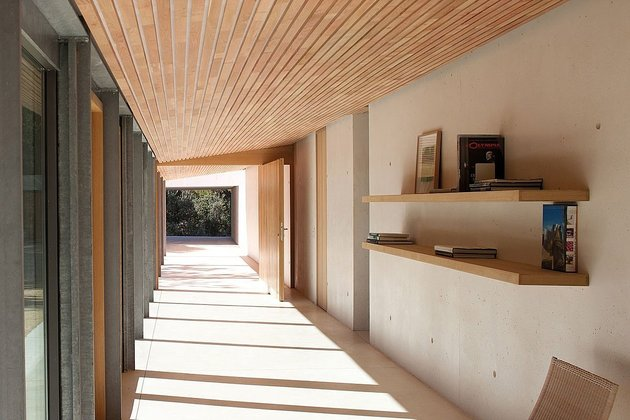 Concrete And Glass Home With Main Level Wood Ceiling