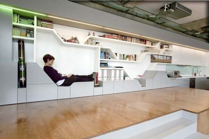 Industrial Loft With Seating Integrated Into Shelves