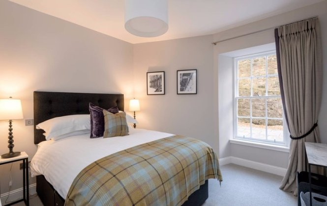 Master Bedroom With Kingsize Bed And Tartan Throw In Edinburgh West End Apartment