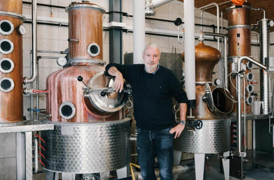 Hans Erismann in his distillery.  For the Hard Seltzer he uses a schnapps from his own production.