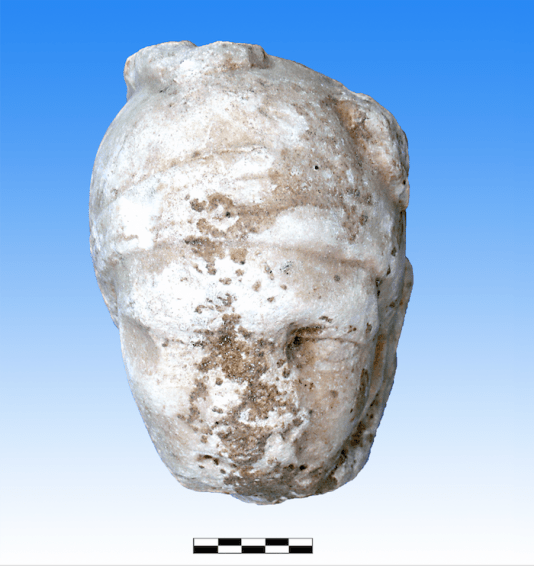 Roman-era carved marble head of an Amazon or warrior, possibly broken off from a tomb