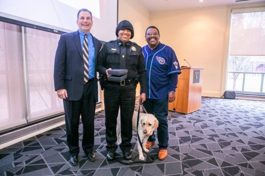 The Vice Chancellor for Administration established an annual divisional awards program to celebrate staff members for excellence in service, dedication to community values, and exceptional performance. (L-R: Eric Kopstain, Shaneithia Lewis, Corporal Jack, August Washington)