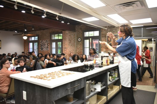 """At the New Orleans School of Cooking, students on the Black History Immersion Excursion received a demonstration and history lesson on Creole cooking. """"This was the best meal of the excursion,"""" said Noble. (Rosevelt Noble/Vanderbilt)"""