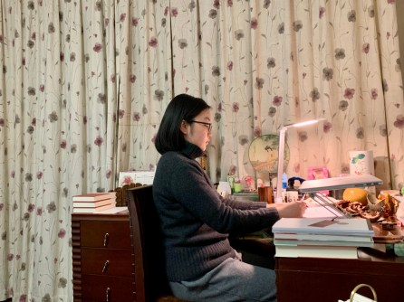 Chen showing her remote learning space in her home.
