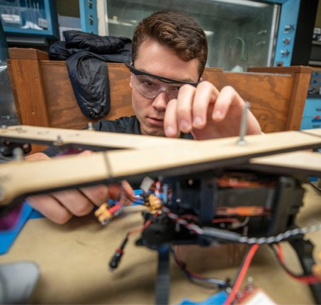 Mark Scherer assembles the autonomous unmanned aerial vehicle. Two UAVs are being designed to conduct collaborative spatial mapping, image-based guidance and localization, and autonomous navigation for this year's NASA competition. (Vanderbilt University/John Russell)
