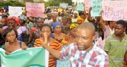 health workers protest - FG begs JOHESU to shelve plan strike