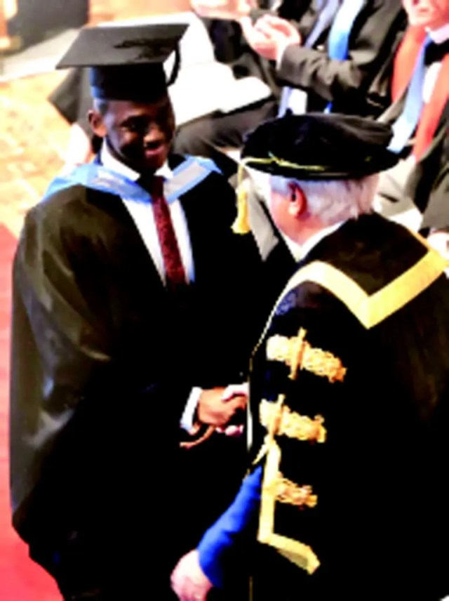 •Obi Akaeze(left)being congratulated by a don amidst other graduands during his graduation in Uk.