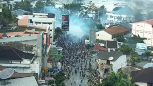 Protesters torch buildings as new unrest erupts in Indonesia's Papua