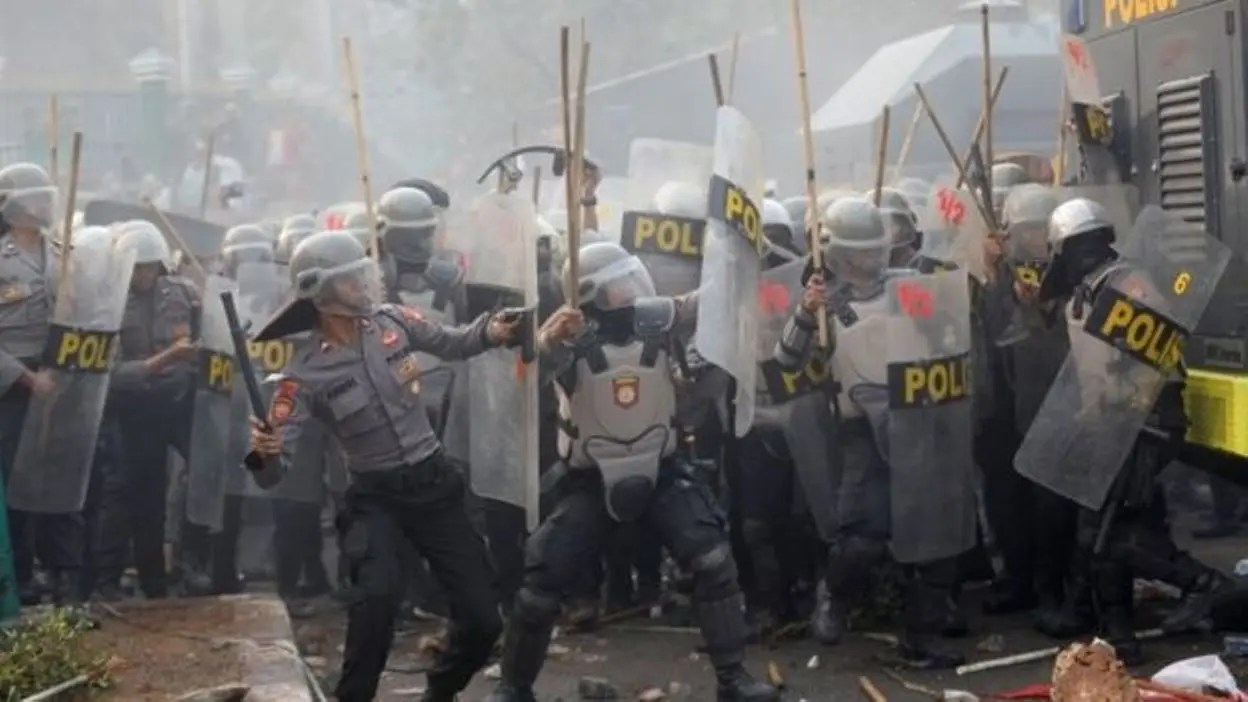Police fire tear gas at demonstrators during third day of Indonesian protests