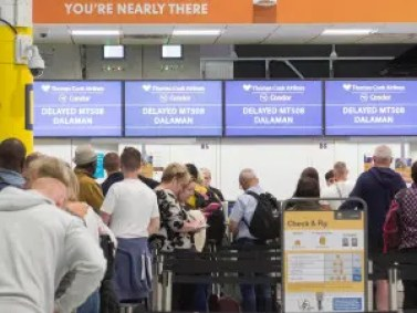 Thomas Cook customers watching as their flights were cancelled.
