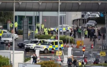 Police officers are seen as a suspect package was found at Manchester Airport