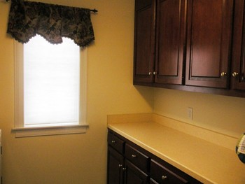 2nd floor laundry room, w/cabinets on one side & the w/d, plus sink, is on the other