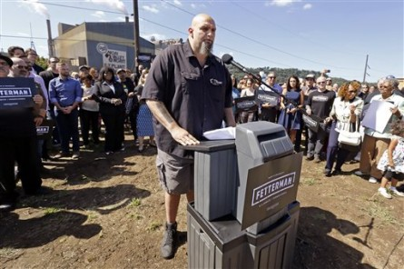 John Fetterman, the mayor of Braddock, Pa., addresses a crowd while announcing his candidacy for the U.S. Senate, Monday, Sept. 14, 2015, in Braddock. (AP Photo/Keith Srakocic)