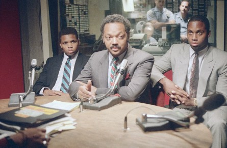 Rev. Jesse Jackson, center, is flanked by sons Jonathan, left, and Jesse Luther Jr., as he makes a guest appearance on radio station W.L.I.B. in New York in 1988. (Frankie Ziths/AP File Photo)