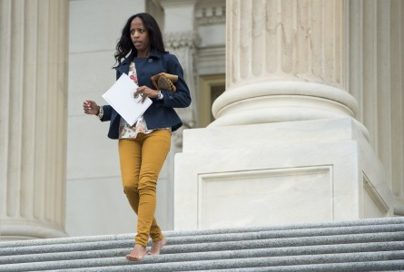 UNITED STATES - OCTOBER 9: Rep. Mia Love, R-Utah, runs down the House steps barefoot as she leaves the Capitol for the Columbus Day recess after final votes on Friday Oct. 9, 2015. (Photo By Bill Clark/CQ Roll Call)