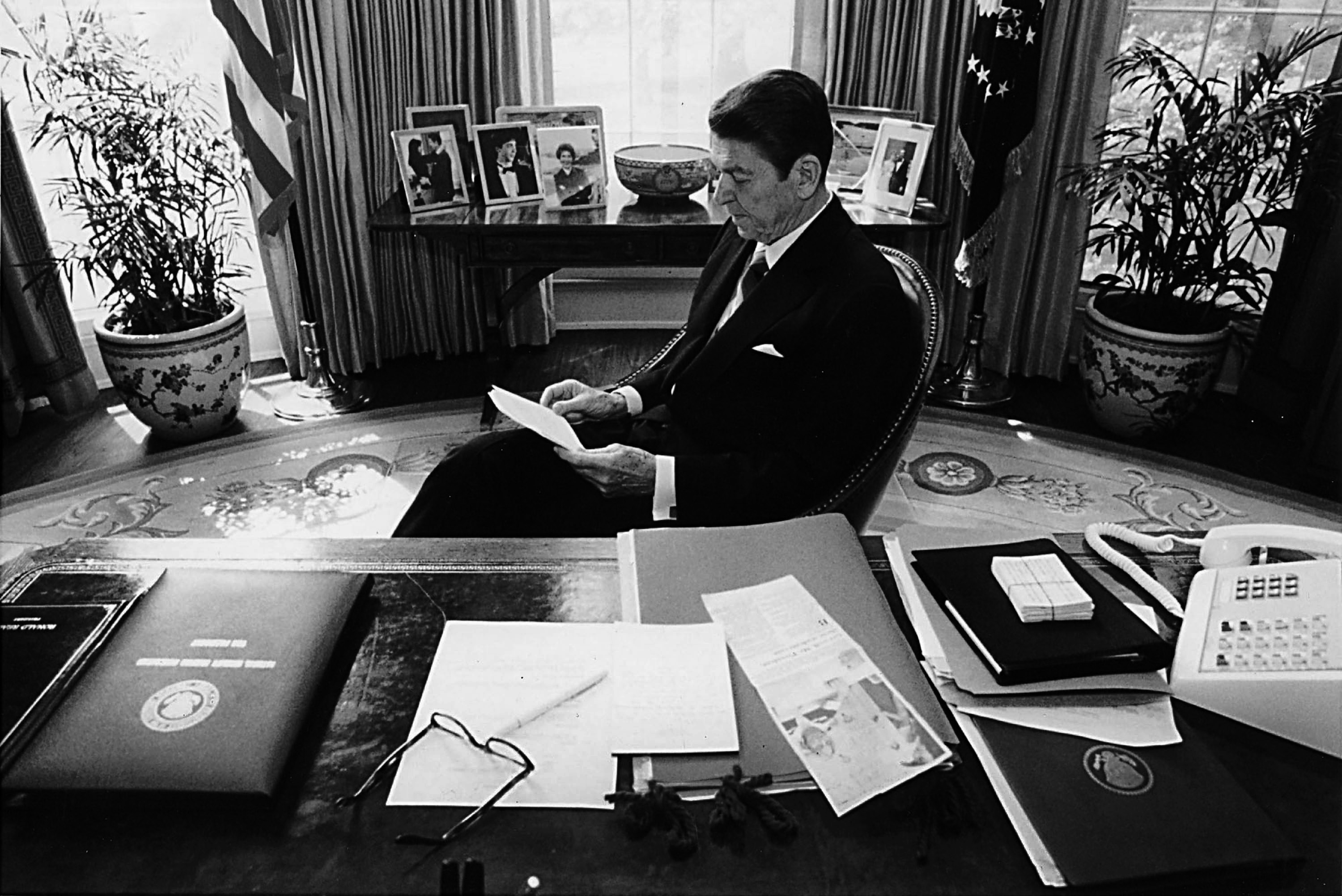 President Ronald Reagan prepares a speech at his desk in the Oval Office in 1981. (Photo by Michael Evans/The White House/Getty Images)