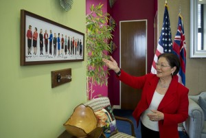 Hirono shows off a photograph of the women Senators in her Capitol Hill office on Friday, March 11, 2016. (Photo By Bill Clark/CQ Roll Call)