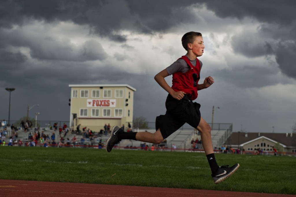 UNITED STATES - APRIL 21: A student runs in a track meet at the Yorkville, Ill., High School, April 21, 2016. Former House Speaker Dennis Hastert, R-Ill., who once taught high school and coached wrestling at the school, will be sentenced on April 27th for trying to cover up money transactions meant to pay off a student who alleged that sexual abuse took place when Hastert was a teacher. (Photo By Tom Williams/CQ Roll Call)