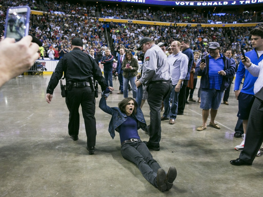 Protestors removed from an April Trump rally in Buffalo, N.Y. (Photo By Al Drago/Roll Call)