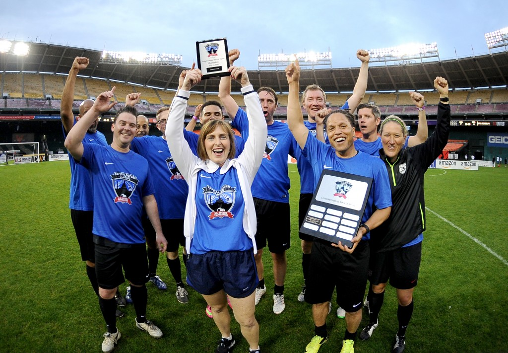 The Democratic team celebrates its win. (Courtesy U.S. Soccer Foundation)