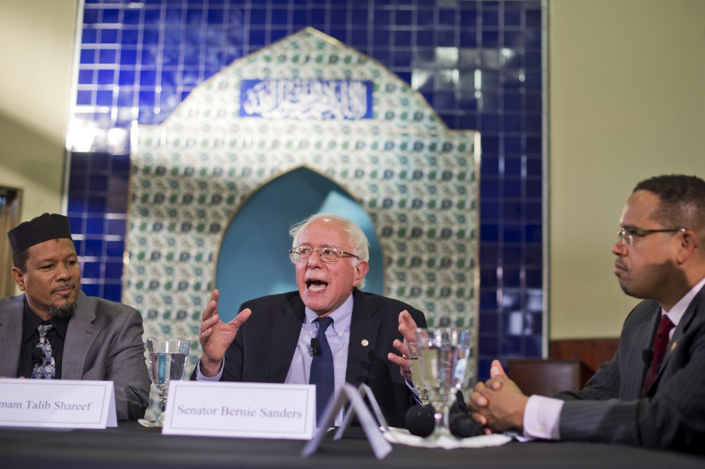 Minnesota Rep. Keith Ellison, right, has endorsed Sen. Bernie Sanders for president. The two are seen at roundtable discussion on religion in Washington in December. (Tom Williams/CQ Roll Call)