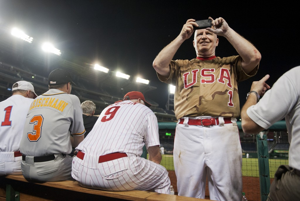 Rep. Kevin Brady of Texas takes a picture of the crowd during the 53rd Congressional Baseball Game in Nationals Park in 2014. (Tom Williams/CQ Roll Call File Photo)