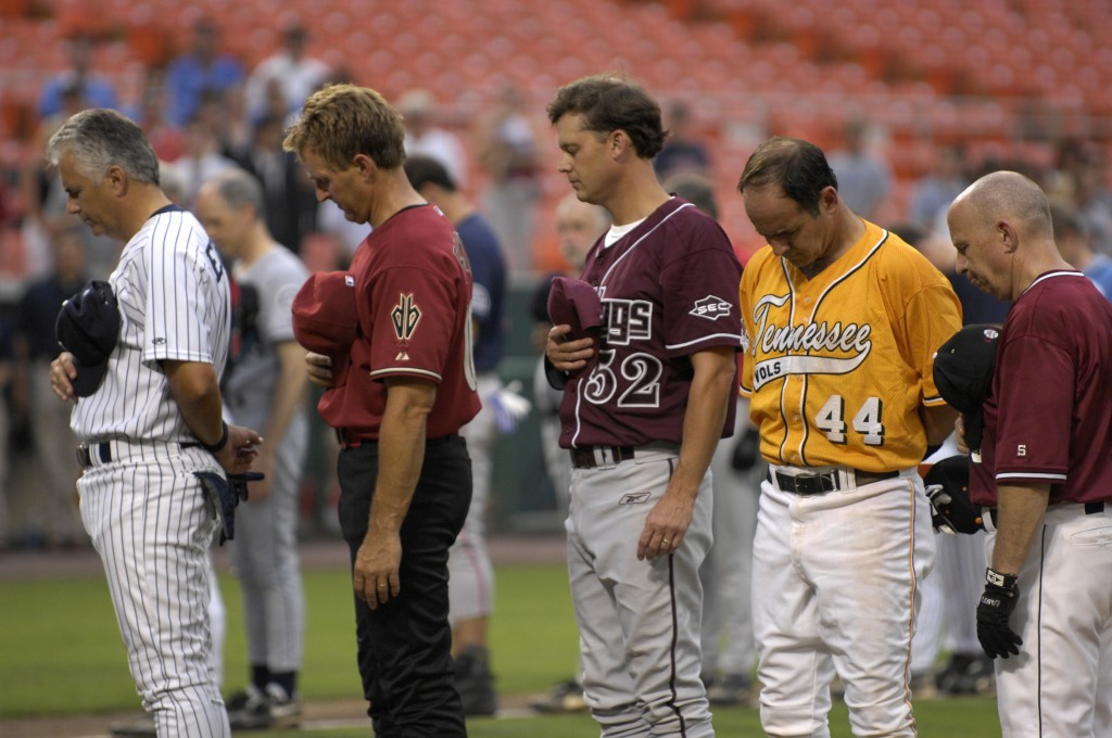 Republican players Sen. John Ensign of Nevada, and Reps. Jeff Flake of Arizona, Chip Pickering of Mississippi, Zach Wamp of Tennessee and Kevin Brady of Texas, bow their heads during a moment of silence at the 46th Annual Roll Call Congressional Baseball Game in 2007. (CQ Roll Call file photo)