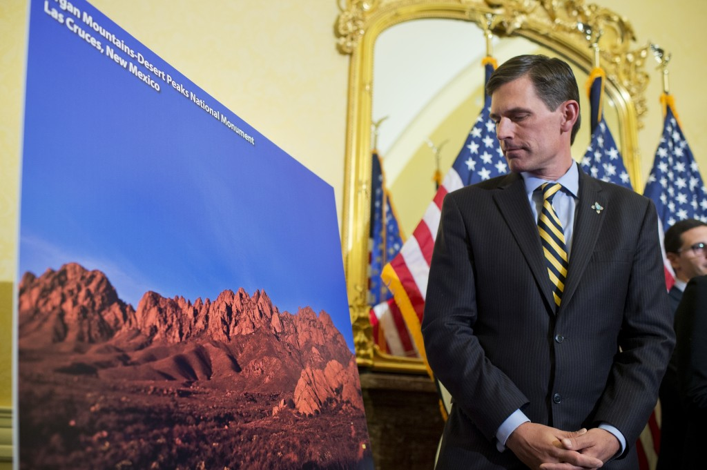UNITED STATES - APRIL 06: Sen. Martin Heinrich, D-N.M., views a picture of Organ Mountains-Desert Peaks National Monument in New Mexico, during a news conference in the Capitol about how the a designation of an area as a national monument can help tourism, small business, and the economy, April, 06, 2016. (Photo By Tom Williams/CQ Roll Call)
