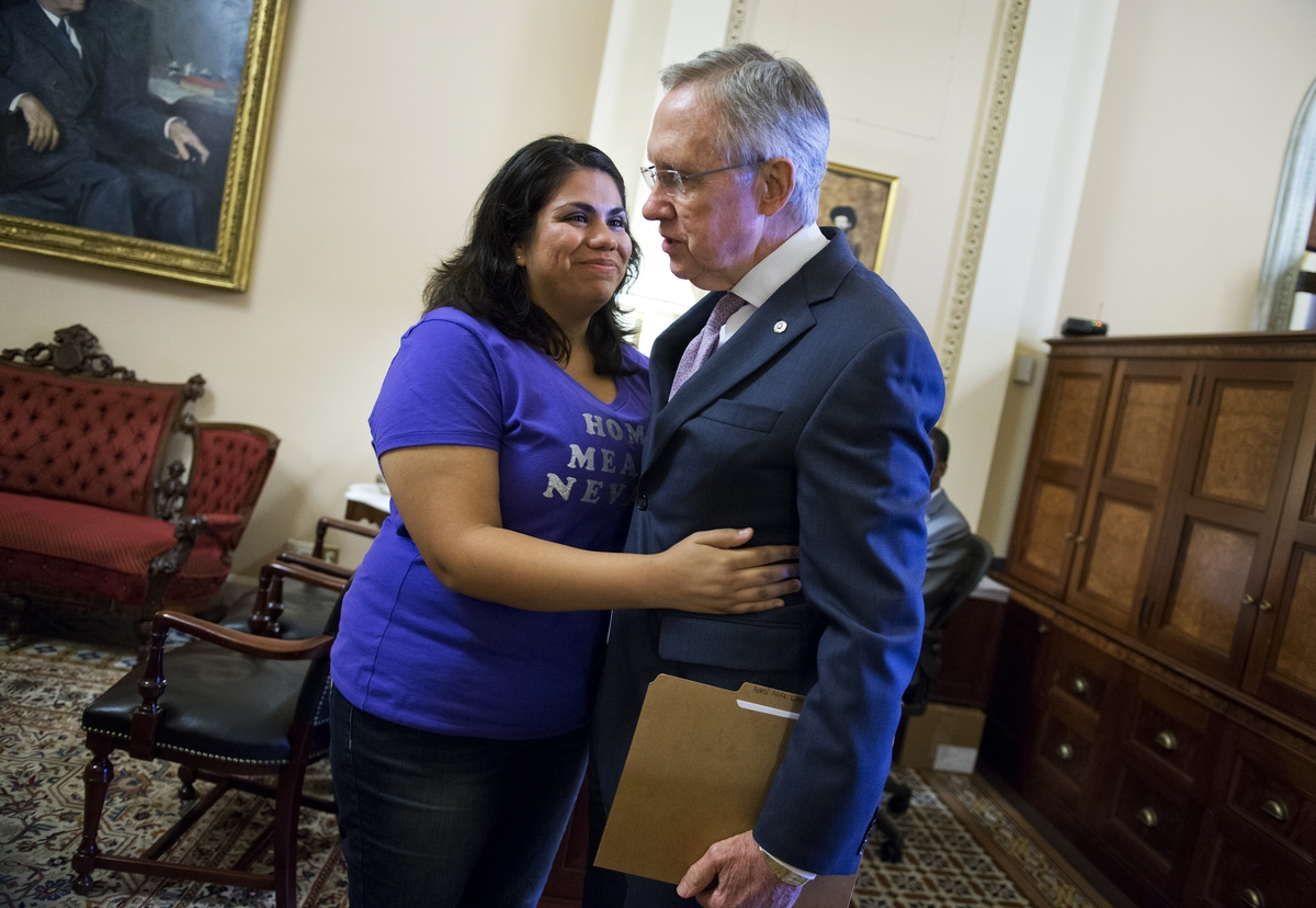 Astrid Silva meets with Sen. Harry Reid in his Capitol Hill office in June 2013. (Tom Williams/CQ Roll Call File Photo)