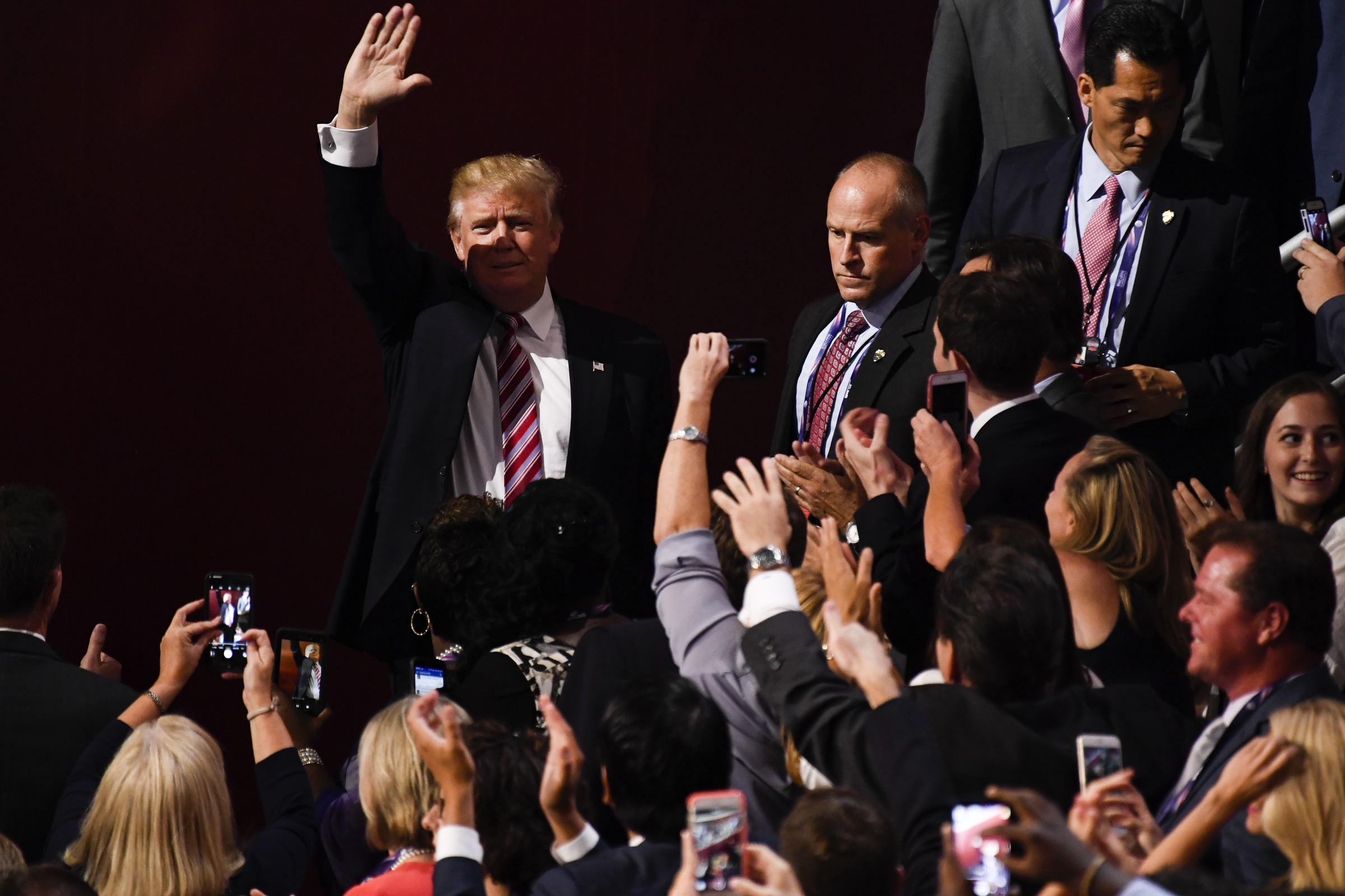 UNITED STATES - JULY 20: Republican Presidential nominee Donald Trump waves as he arrives in the Quicken Loans Arena at the 2016 Republican National Convention in Cleveland, Ohio on Wednesday July 20, 2016. (Photo By Bill Clark/CQ Roll Call)