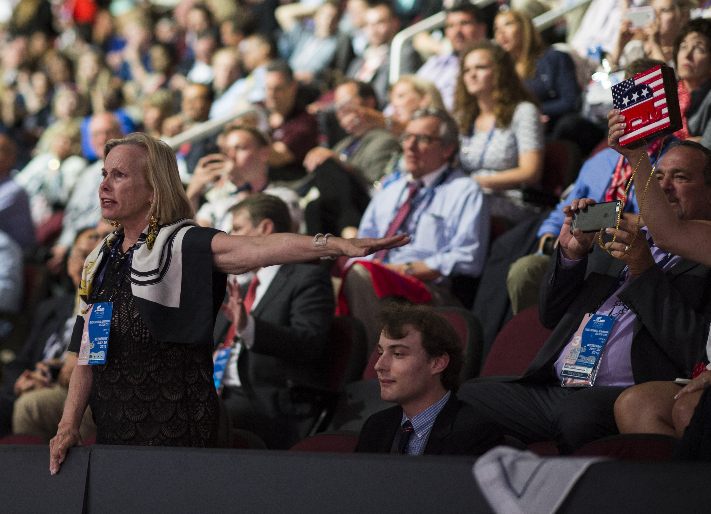 UNITED STATES - JULY 20: A woman in the upper seating area yells