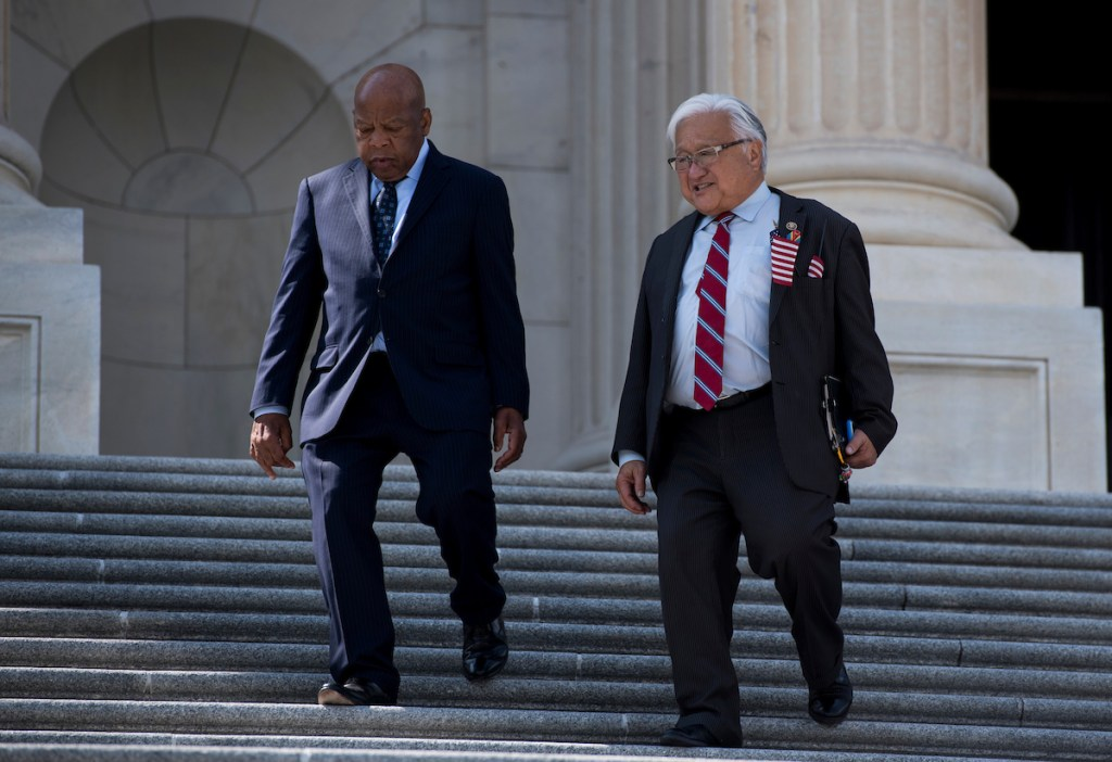 Rep. John Lewis, D-Ga., left, and Rep. Mike Honda, D-Calif., walk down the House steps at the Capitol following a vote on Thursday, Sept. 8, 2016. (Bill Clark/CQ Roll Call)