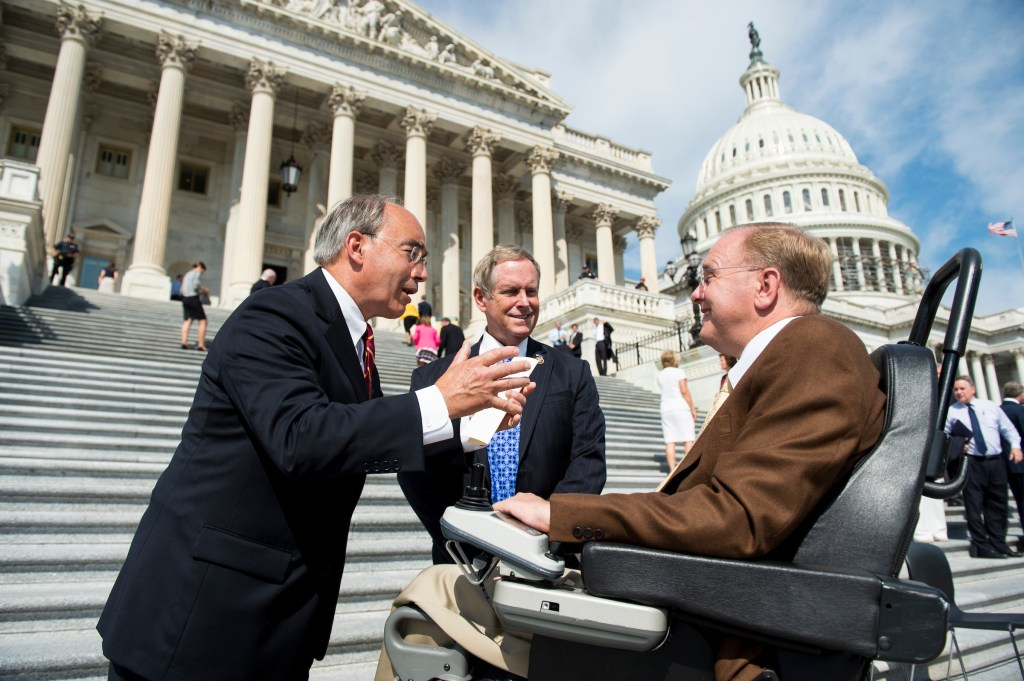 From left, Rep. Bruce Poliquin, R-Maine, Rep. Joe Wilson, R-S.C., and Rep. Jim Langevin, D-R.I., talk at the House steps after the conclusion of the ceremony to mark the 15th anniversary of 9/11on Friday, Sept. 9, 2016. (Bill Clark/CQ Roll Call)
