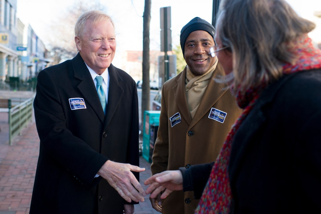 UNITED STATES - MARCH 26: Darrel Thompson, candidate for the DC city council Ward 6 seat, and his former boss and former Majority Leader Dick Gephardt shake hands with local residents outside of Peregrine Espresso on Capitol Hill on Wednesday, March 26, 2014. Gephardt came out to go door to door campaigning with Thompson in advance of next week's election. (Photo By Bill Clark/CQ Roll Call)