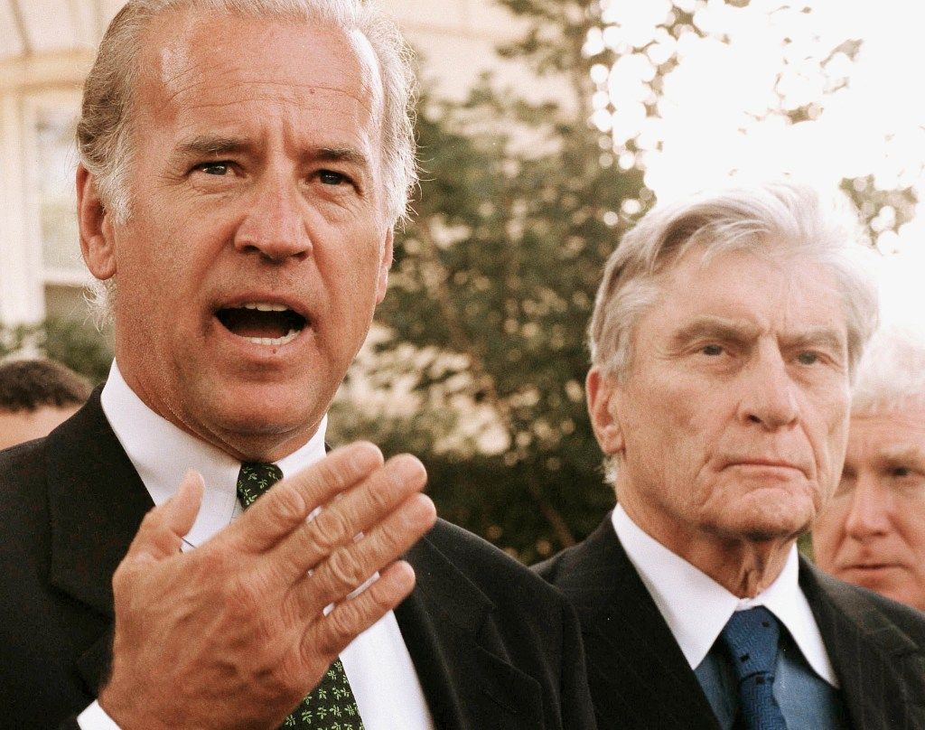 Senate Foreign Relations Chairman Joseph R. Biden Jr. and Senate Armed Services ranking Republican John Warner talk to media outside U.S. Capitol Police Headquarters in the early afternoon of Sept. 11, 2001. (Scott J. Ferrell/CQ Roll Call file photo)